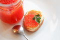Red caviar sandwiches with butter and and near spoon and jar Stock Photography