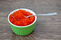 Red caviar with spoon close up fresh in a green bowl Royalty Free Stock Photos