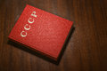 Red cccp book on the table wooden scratched written cover Royalty Free Stock Photo
