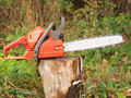 Red chainsaw Stock Images