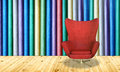 Red chair on colorful wall background Royalty Free Stock Image