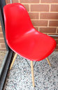 Red chair plastic in coffee room Royalty Free Stock Photo