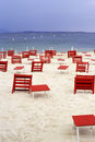 Red chairs on a empty beach Stock Photo