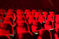 Red chairs on the empty cinema auditorium Stock Image