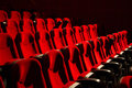 Red chairs on the empty cinema auditorium Stock Photography