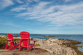 Red chairs facing Keji Seaside beach (South Shore, Nova Scotia,