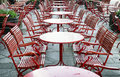 Red chairs sidewalk cafe table and chair Royalty Free Stock Image