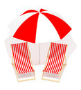 Red chaises longue and umbrella Royalty Free Stock Image