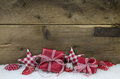 Red checked christmas presents on wooden country style backgroun Royalty Free Stock Photo