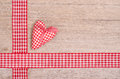 Red checkered heart and ribbon on wood as background Royalty Free Stock Photography