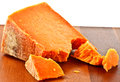 Red cheese a wedge of leicestershire on a wooden board Royalty Free Stock Image