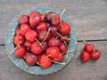Red cherries fresh in the stone cup Stock Photo