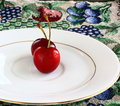 Red Cherries on a white plate Royalty Free Stock Photo