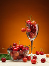 Red cherry tasty fresh and ripe in the glass on wooden table Stock Images