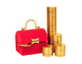 Red chest and columns of yellow coins Stock Images