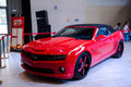 A red chevy car take on the th chongqing international motor show june th th there are many international famous brand companies Stock Images