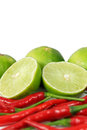 Red chili and limes Stock Photos