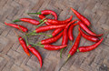 Red chili peppers on bamboo weave background Royalty Free Stock Photos