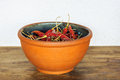 Red chilis in a bowl on wood table Royalty Free Stock Photography