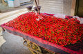 Red chilli or peppers stacked on sales trolly in soukh of medina, Fez, Morocco Royalty Free Stock Photo