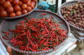 Red chilli peppers in vietnam chili lychees and tomatos a market sapa Royalty Free Stock Photo