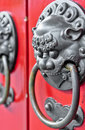 Red chinese door with a lion/dragon head. Concept: Chinese New Year celebration. Royalty Free Stock Photo