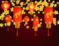 Red Chinese lanterns hanging in the park. A cylindrical shape with a pattern.