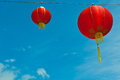 Red chinese paper lanterns against a blue sky horizontal shot Stock Photos