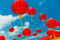 Red chinese paper lanterns against a blue sky horizontal shot Royalty Free Stock Image