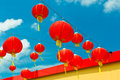 Red chinese paper lanterns against a blue sky horizontal shot Stock Photography