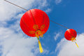 Red chinese paper lanterns against a blue sky horizontal shot Royalty Free Stock Photos