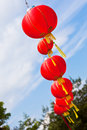 Red chinese paper lanterns against a blue sky vertical shot Stock Image