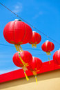 Red chinese paper lanterns against a blue sky vertical shot Royalty Free Stock Image