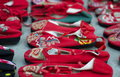Red chinese slippers for sale in a market Royalty Free Stock Image