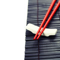 Red chopsticks on a bamboo serving mat Stock Photography