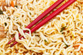 Red chopsticks on cooked instant ramen close up Stock Photography