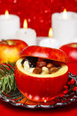 Red christmas apples stuffed with dried fruits Royalty Free Stock Images