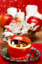 Red christmas apples stuffed with dried fruits Stock Photo
