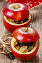 Red christmas apples stuffed with dried fruits in honey Stock Image