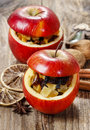 Red christmas apples stuffed with dried fruits in honey Royalty Free Stock Image