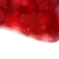 Red christmas background with blurry lights shiny light effects and glittering snowflakes in shades of and a wavy contour great Royalty Free Stock Photos