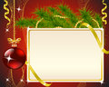 Red christmas background card fir branch a toy and gold ribbons on Royalty Free Stock Image