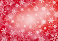 Red Christmas background with snowflakes Stock Images