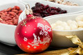 Red christmas bal with chocolate nuts Royalty Free Stock Photo