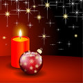 Red christmas ball and candle background Royalty Free Stock Images