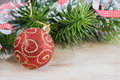 Red christmas ball and fir branches Stock Photography