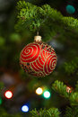 Red christmas ball on firtree with ornament Royalty Free Stock Photography