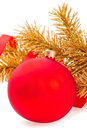 Red christmas ball on golden fir tree branch Stock Images
