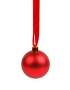 Red christmas ball hanged on ribbon Royalty Free Stock Images