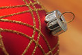Red christmas ball macro closeup of with golden decorations Royalty Free Stock Images